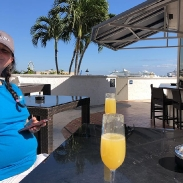 Mimosas with a view of our cruise ship